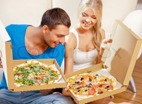 4822884-romantic-couple-eating-pizza-at-home